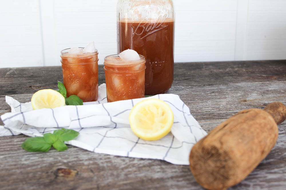 set up glasses of watermelon basil lemonade with napkin