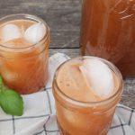 upclose shot of watermelon basil lemonade in a mason jar