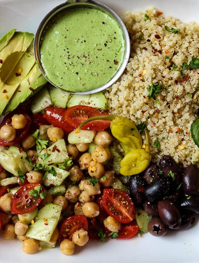 Mediterranean Quinoa Salad Bowl With Green Goddess Dressing in a bowl, close up shot