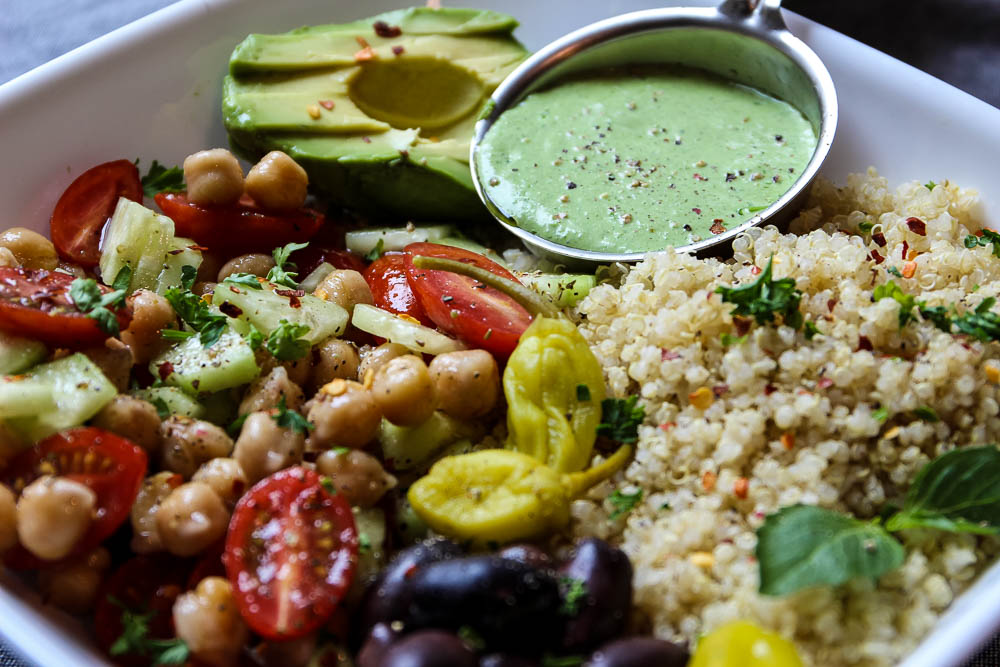 Mediterranean Quinoa Salad Bowl With Green Goddess Dressing horizontal shot