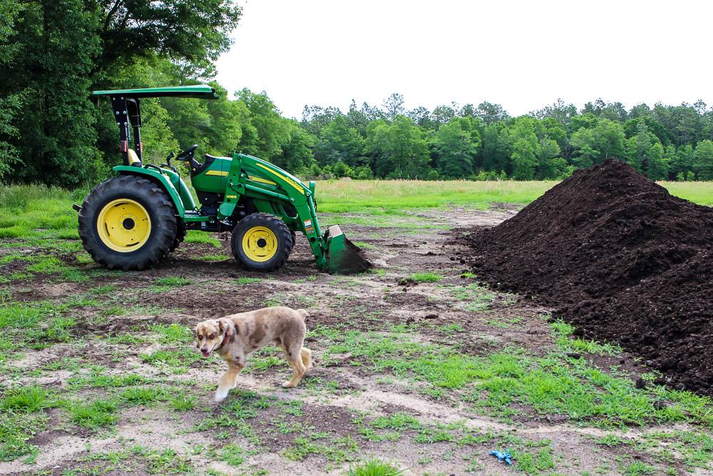John Deere tractor with mushroom compost