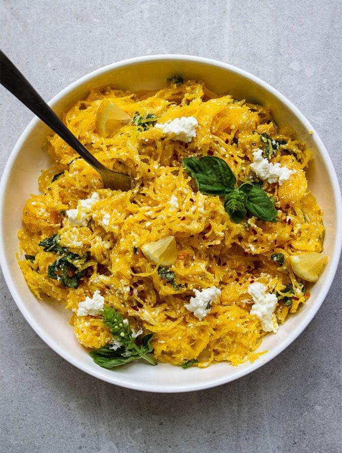 lemon ricotta spaghetti squash in a white bowl