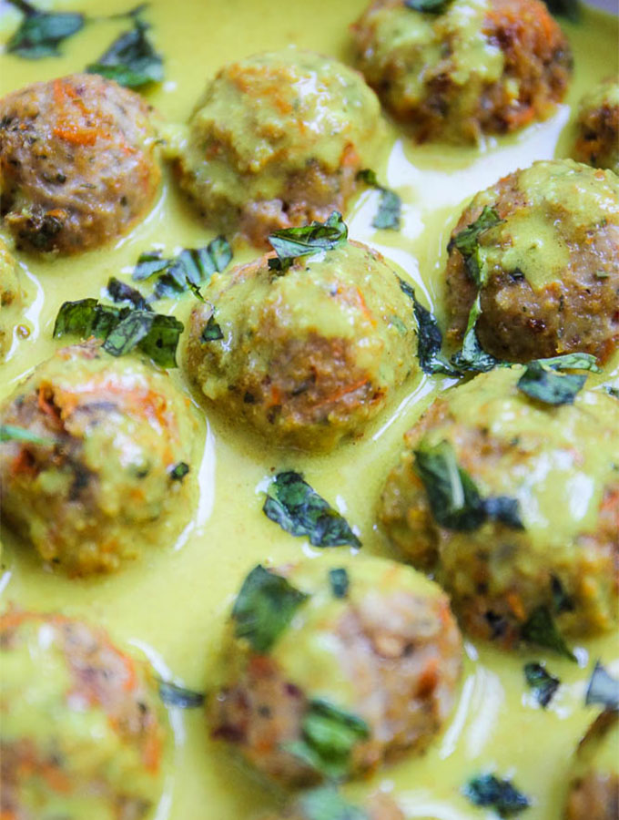 closeup of creamy coconut curry chicken meatballs in the curry sauce