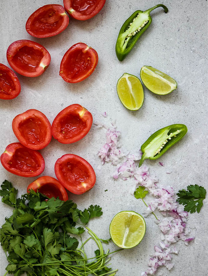 pic de gallo ingredients include roma tomatoes, red onion, cilantro, limes, and jalapeno.