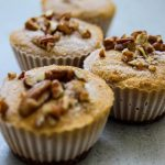 Vegan Pumpkin Cheesecake with pecans in a row