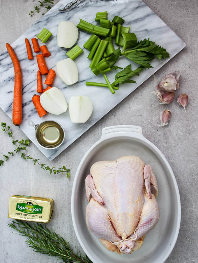whole roasted chicken with white wine and fresh herbs ingredients include a whole chicken, carrots, onion, celery, and a few fresh herb.