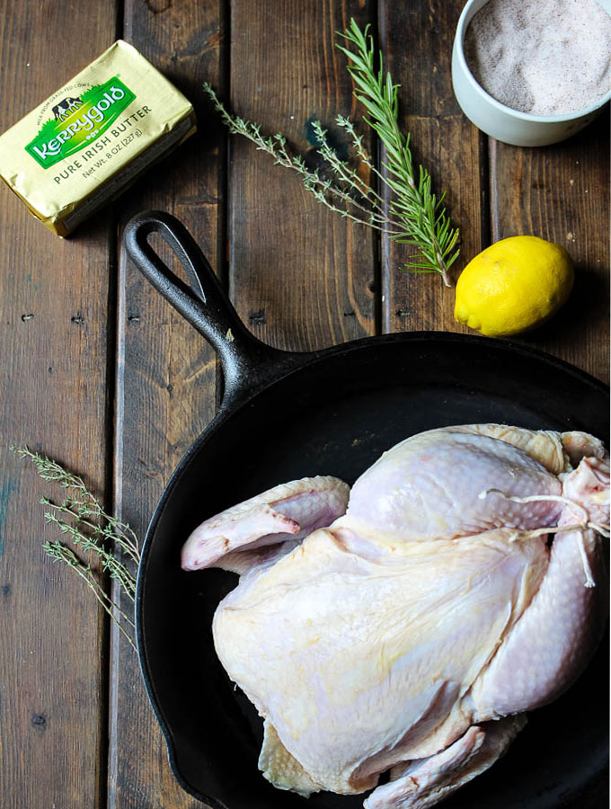 Lemon and herb chicken ingredients include fresh rosemary, thyme, butter, garlic, lemon, and salt.