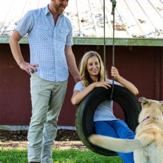 Meredith and Steve Elliott posed on a tire swing on Maeday Farm