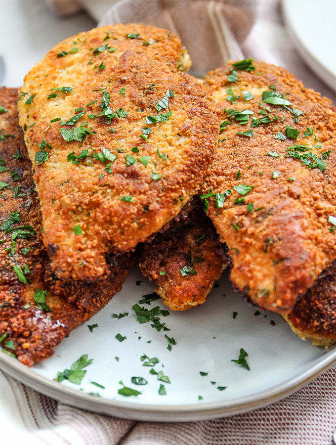 Parmesan crusted chicken is topped with fresh parsley for looks and taste!