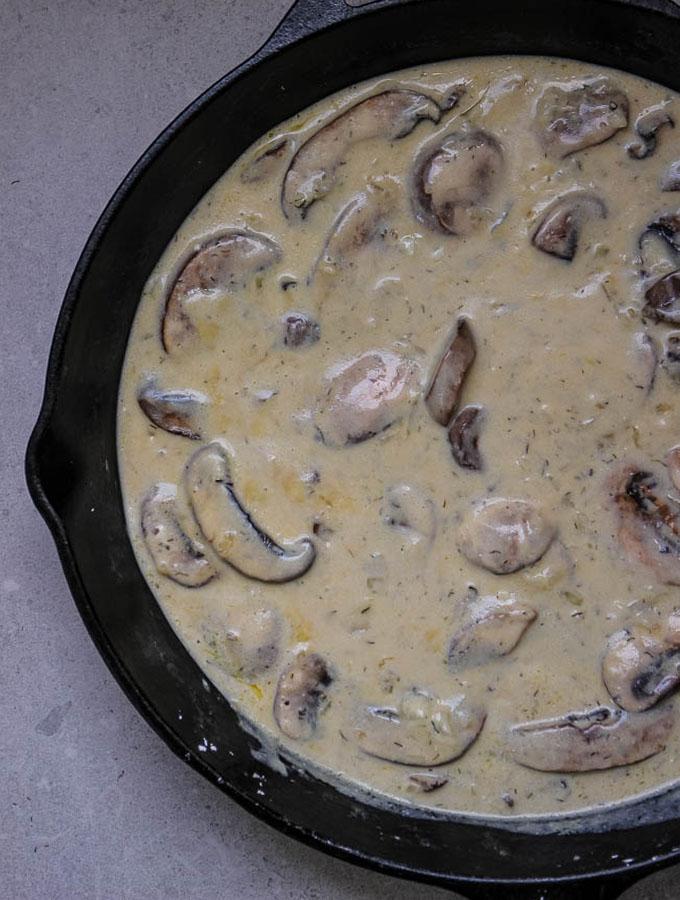 Vegetarian mushroom stroganoff pan sauce is easy to make, using butter, mushrooms, garlic, white wine, vegetable broth, sour cream and dijon mustard.