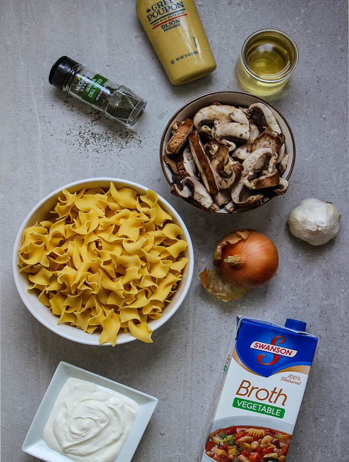 Mushroom stroganoff ingredients include mustard, broth, dill, garlic, onion, and white wine.