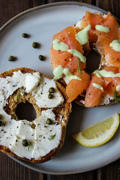 Lox and bagels is made with smoked salmon, cream cheese, toasted bagels, capers, and topped with a cucumber lemon sauce for added flavor!