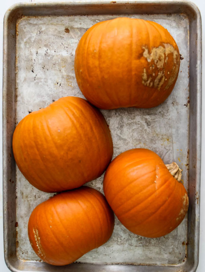 Pumpkin puree is made from scratch by cutting the pumpkins in half, then roasting them on a baking sheet in the oven.