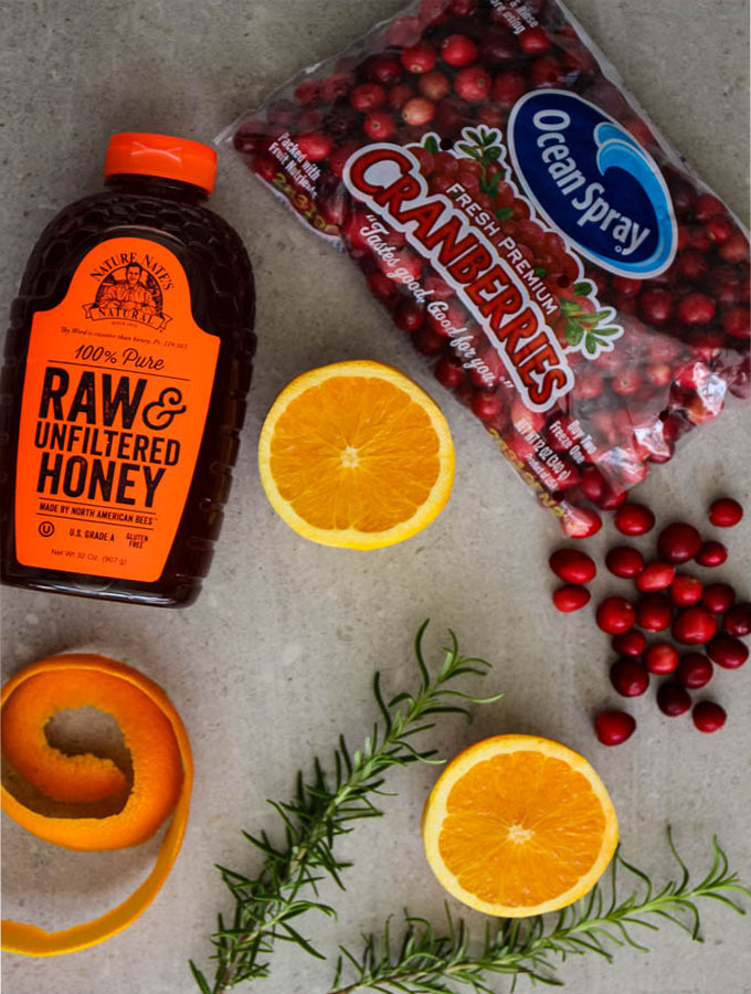 Cranberry sauce is made with simple ingredients like honey, cranberries, oranges, and rosemary