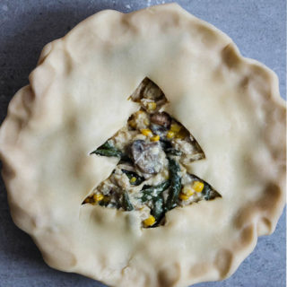 Leftover turkey pot pie is maded with Thanksgiving left overs and has a christmas tree cut out in the center of it for pie ventilation.