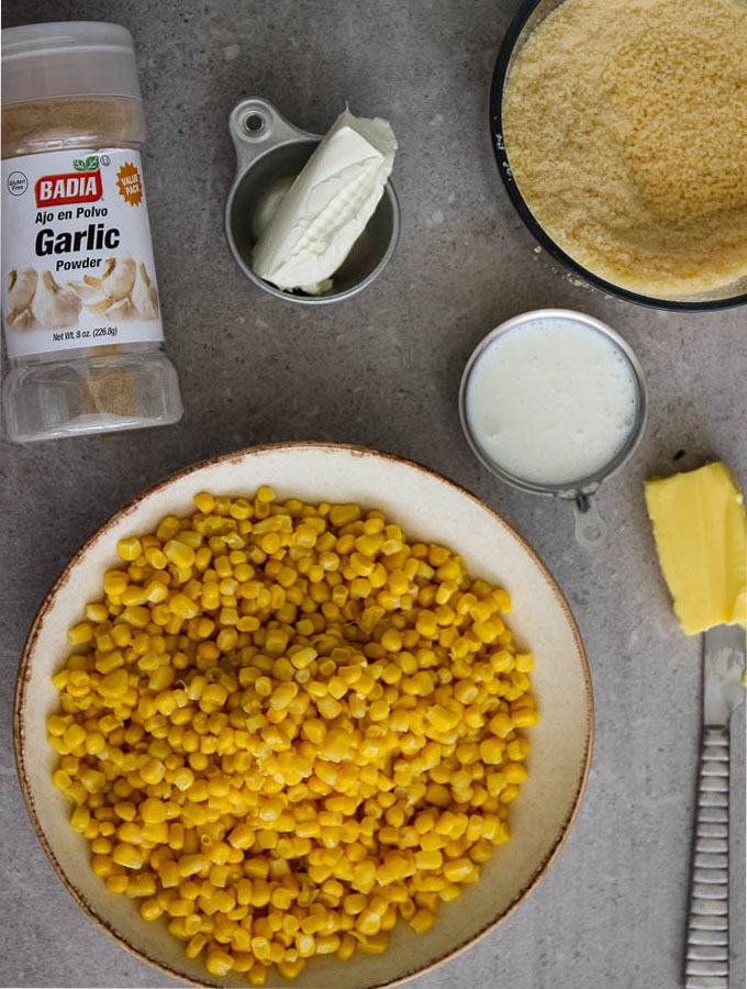 Parmesan creamed corn has simple ingredients like canned organic corn, garlic powder, cream cheese, milk, butter, and parmesan cheese.