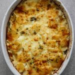 Potato au gratin is freshly baked with a crispy top layer of parmesan and mozzarella cheese.