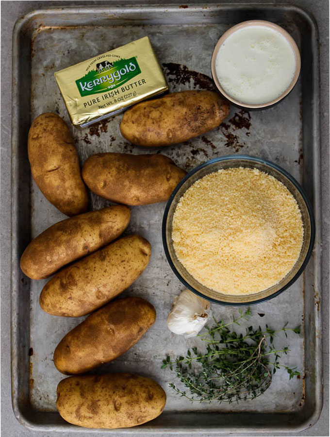 potato au gratin ingredients include potatoes, cheese, herbs, milk and butter.