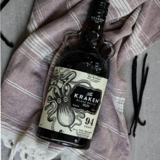Vanilla extract is made easily by slicing the vanilla beans in half and placing htem in Kraken Black Spiced Rum to begin the extraction.