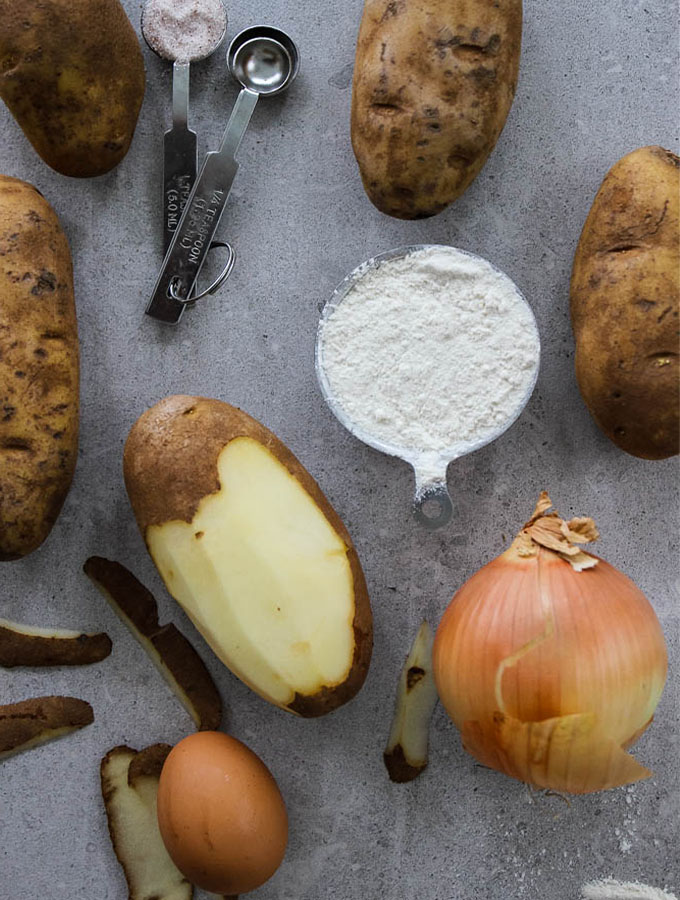Potato latke ingredients include russet potatoes, onion, flour, salt, and an egg.