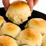 Rosemary Garlic Dinner Rolls are pulled apart to show texture and fluffiness.