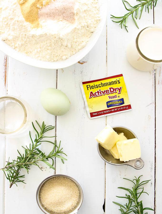 Rosemary Garlic Dinner Rolls ingredients include flour, garlic, salt, milk, yeast, butter, sugar, water and an egg.