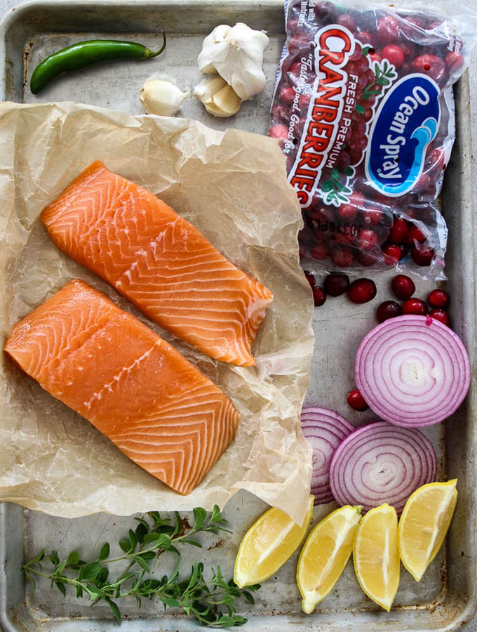 Salmon with Cranberry Relish has ingredients like salmon filets, lemon, garlic, cranberries, red onion, a Serrano pepper and a splash of balsamic vinegarSalmon with Cranberry Relish