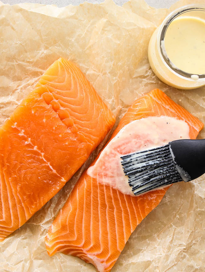 Salmon filets are brushed with a pureed mixture of olive oil, lemon juice and garlic.