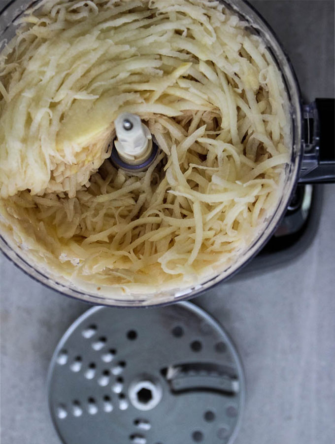 Potato latkes are made easier by shredding them in a food processor.