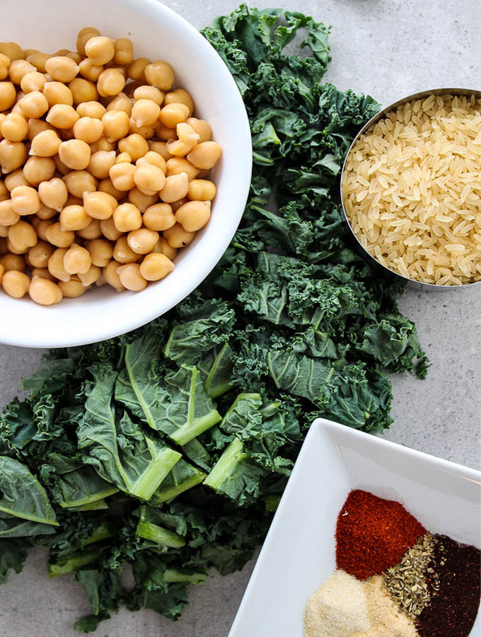 Smoky chickpea and kale rice bowl ingredients include canned chickpeas, fresh kale, white rice, and a few spices.