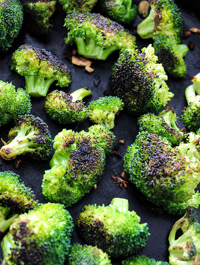 Pan roasted broccoli is browned on each side in the cast iron pan.