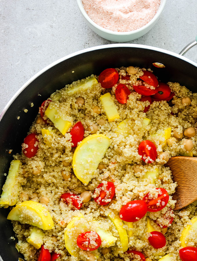 Quinoa salad is made in one pot with zucchini, tomatoes, quinoa and a couple of herbs.