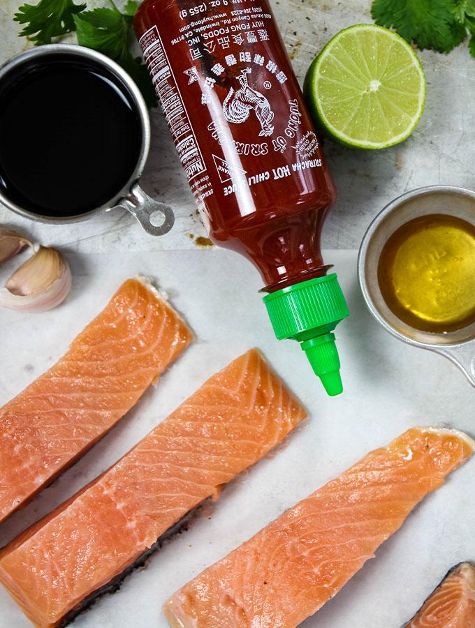 Sriracha Honey Baked Salmon ingredients include salmon, sriracha, lime juice, honey, soy sauce and cilantro.