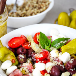 Antipasto Quinoa Salad is plated and topped with white wine vinaigrette.