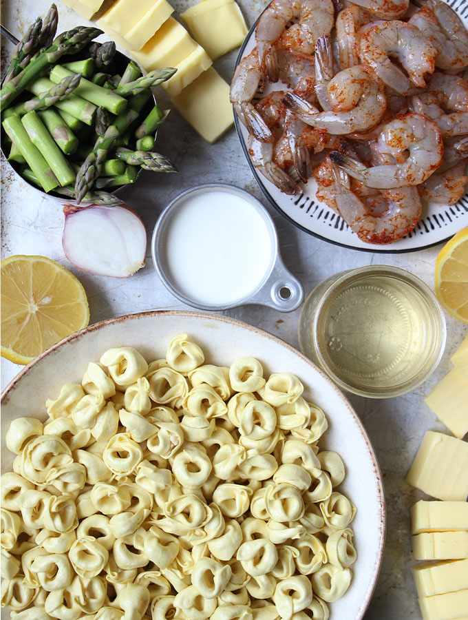 Shrimp and Tortellini with Beurre Blanc ingredients include tortellini, butter, milk, white wine, lemon, shallots, asparagus, shrimp and salt.