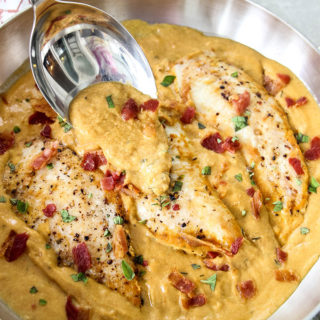Dijon mustard chicken is topped with more sauce to show the creamy texture.