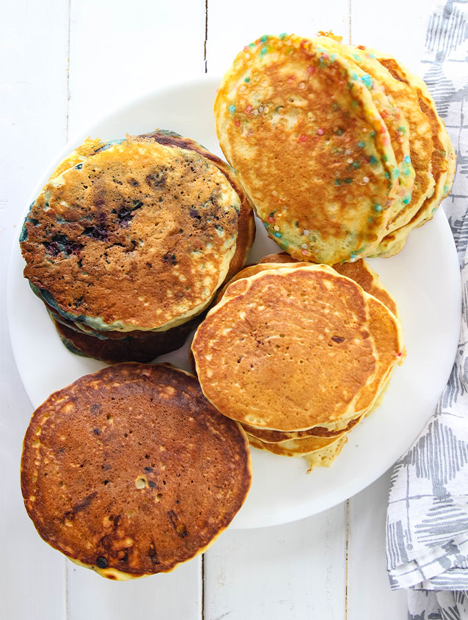 Buttermilk pancakes are made into four different flavors and staked.