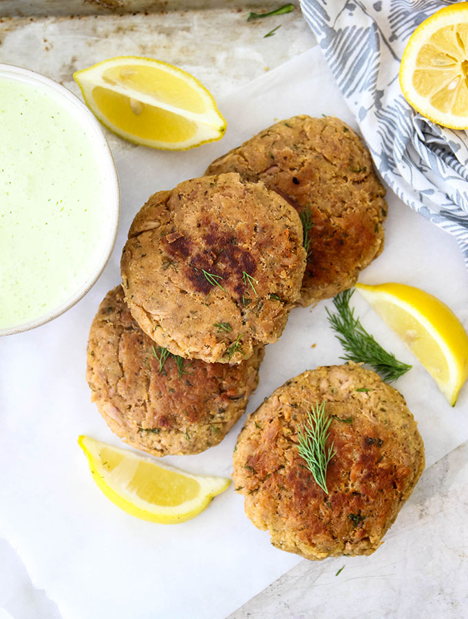 Tuna patties are fresh out of the oven on a baking sheet.