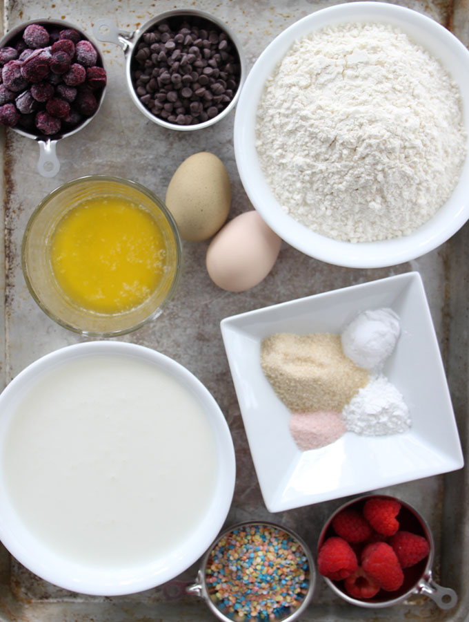 Pancake ingredients are displayed on a baking sheet to show flavors.