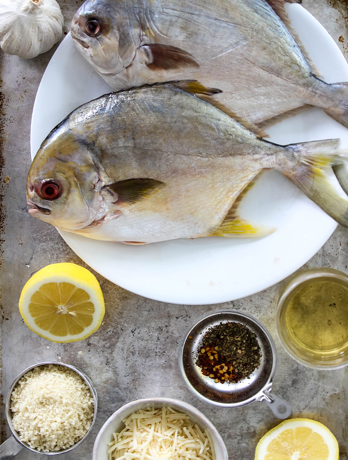 Pompano is stuffed with breadcrumbs, white wine, lemon juice, and parmesan cheese.