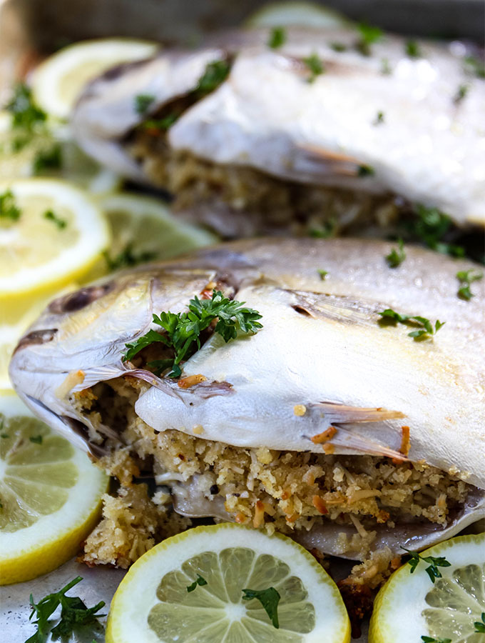 Pompano fish is stuffed with breadcrumbs and baked.