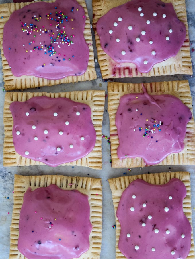 Pop tarts are glazed with icing and topped with sprinkles.