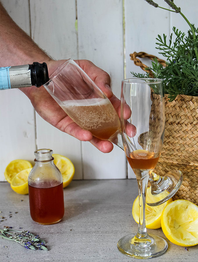 Champagne is poured into a flute over the simple syrup.