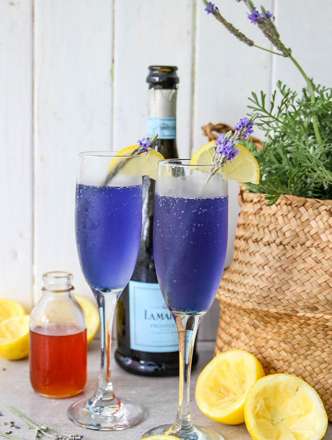 Champagne flutes are filled with lavender lemonade mimosas.