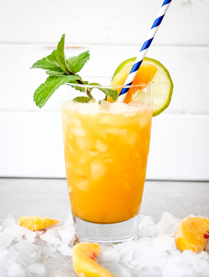 Agua fresca is poured over ice and topped with a straw.