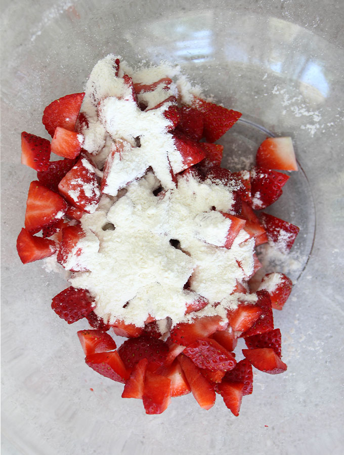Strawberries are tossed in flour to keep them from sinking.