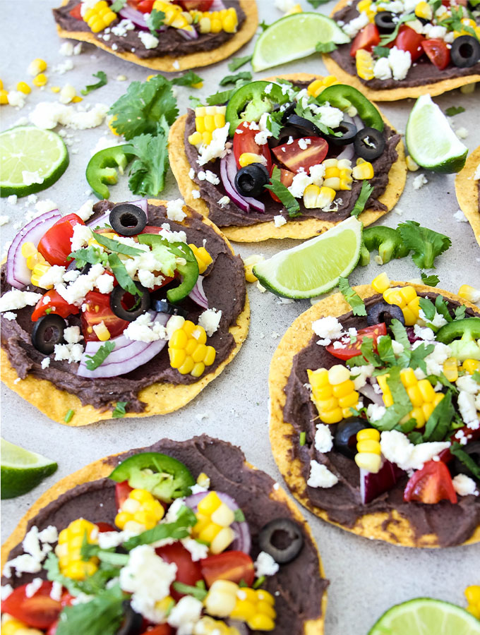 Vegetarian tostadas are topped with all the fixings and fresh cilantro.