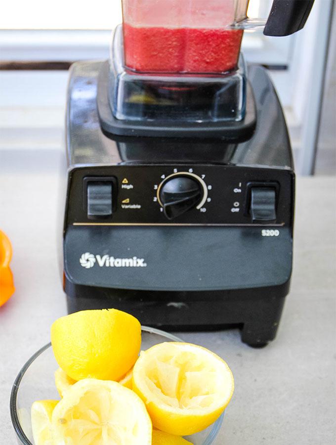 Frozen hibiscus lemonade ingredients are blended in a Vitamix.