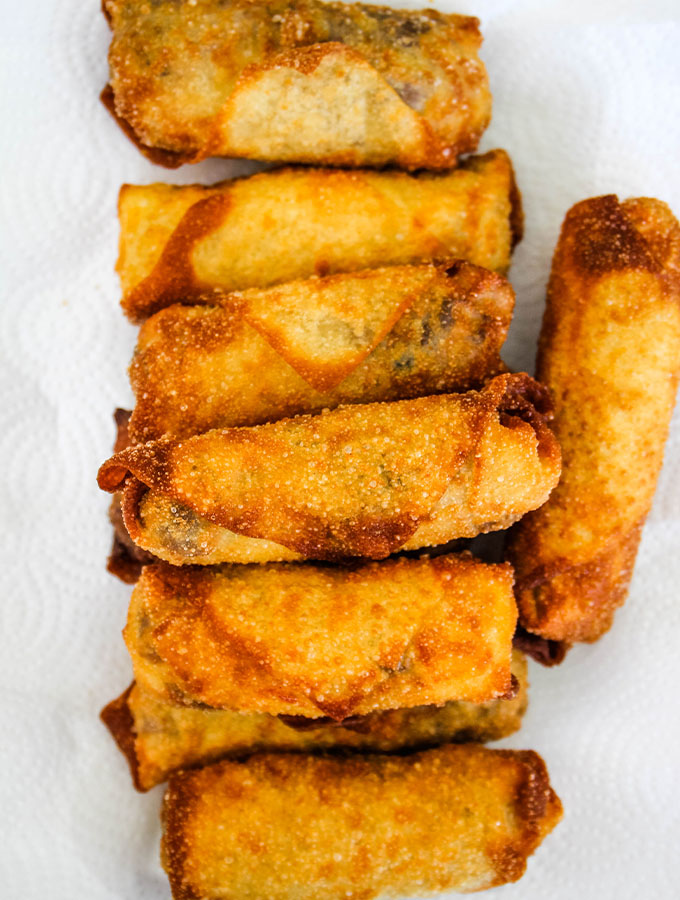 Philly Cheese Steak Egg Rolls are plated on a paper towel after they are deep fried.
