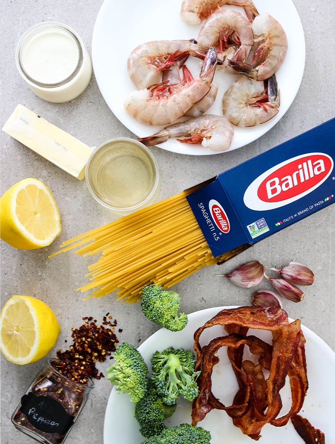 Creamy bacon and shrimp scampi ingredients are displayed individually.